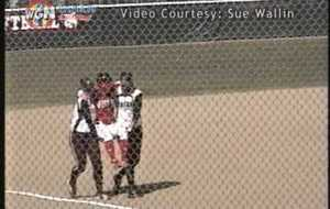Softball player carried around bases by opponents